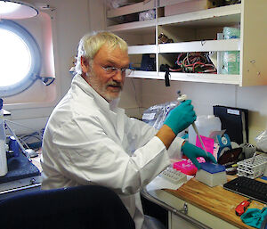 Dr Ulrich Freier processing freshly caught krill for RNA analysis, onboard the Aurora Australis.