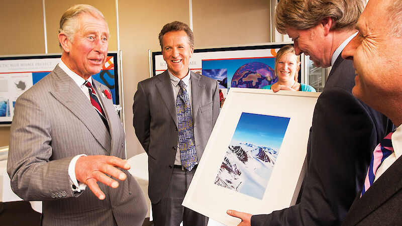 Prince Charles receives a photograph from Antarctic Division Director Dr Tony Fleming.