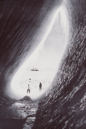 Herbert Ponting's black and white image of the Terra Nova from an ice cave.