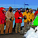 Station Leader Mark Williams conducts the interment ceremony flanked by Mawson expeditioners carrying the ashes of Phil and Nel Law, and the remaining 2011 wintering expedition team.