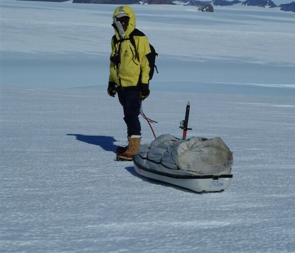 Expeditioner pulling a 'pulk' — a type of sled