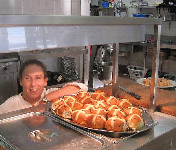 Our chef showing off the hot cross buns she made.