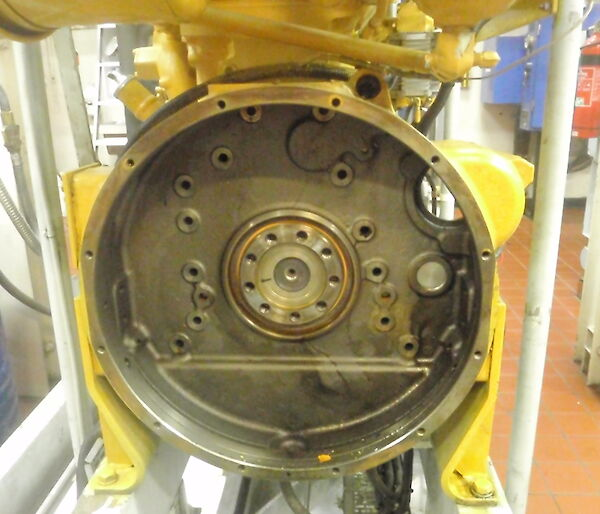 Flywheel housing and in the centre the rear main seal
