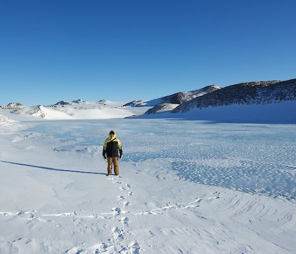 Pete standing on frozen freshwater lake
