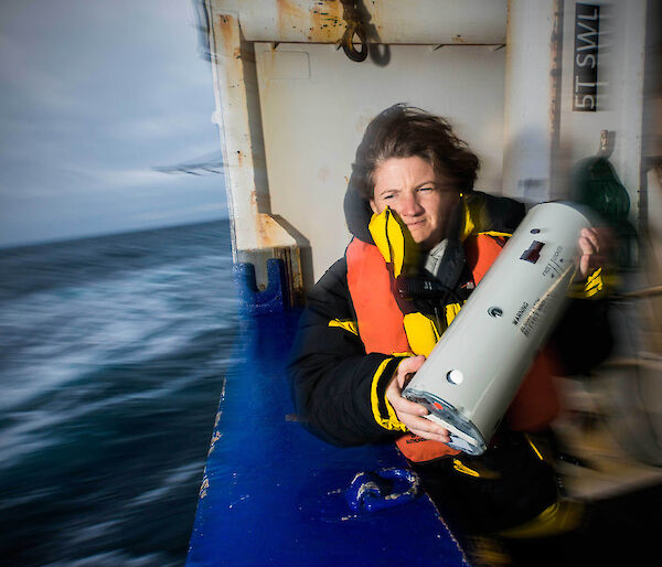 Susie Calderan deploys a sonobuoy off the deck of the New Zealand ship Tangaroa.