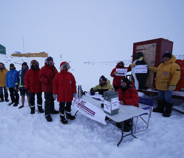 Expeditioners at Davis research station standing in line to vote at an election polling station on the sea ice.