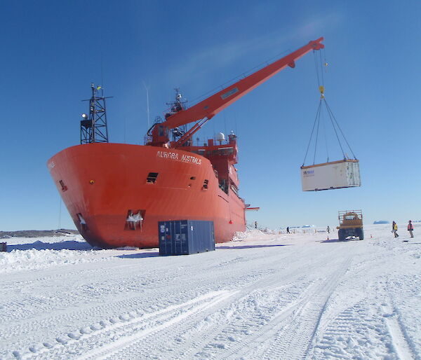 The Aurora Australis unloading cargo on the sea ice at Davis.