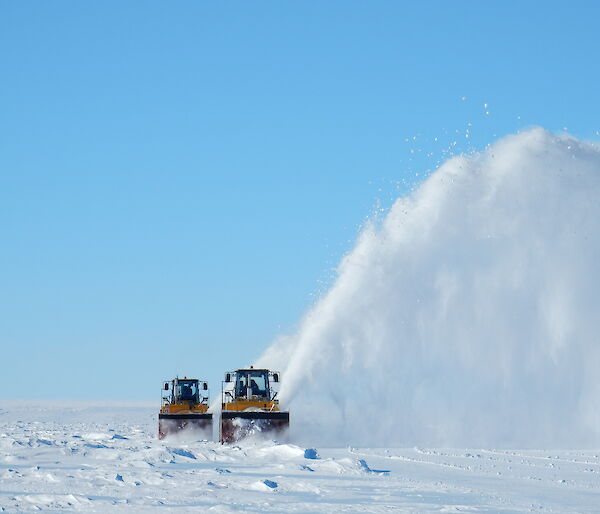 Snow blowers at work on the Wilkins runway