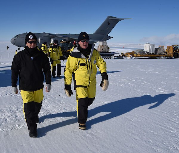 The Governor General (right) and Australian Antarctic Division Director Dr Nick Gales at Wilkins Aerodrome with the C17-A aircraft behind them.