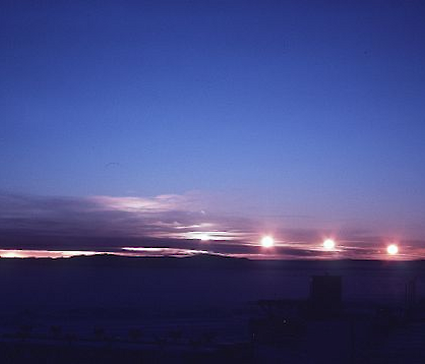 Timelapse photo of midnight sun skimming across horizon