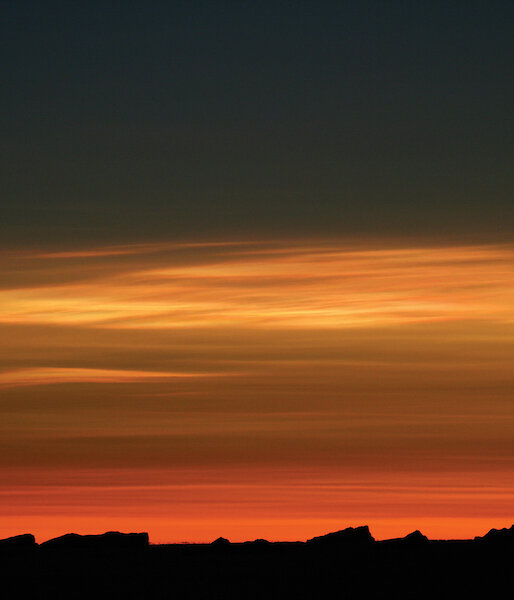 Stratospheric clouds, seen here illuminated by the sun during twilight