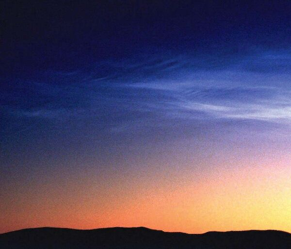 Noctilucent clouds in the Southern Hemisphere are dimmer, less frequent and higher than those in the Northern Hemisphere