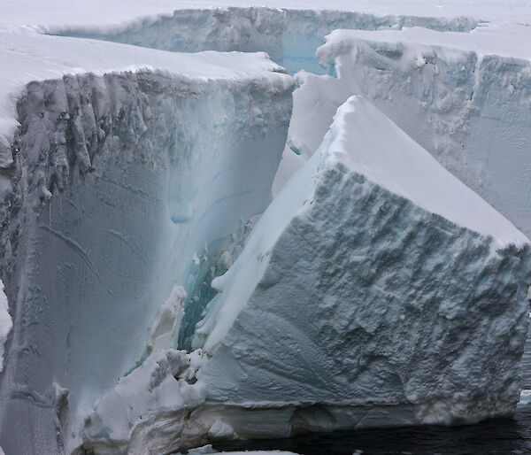 Ice calving from an ice cliff face in Antarctica.