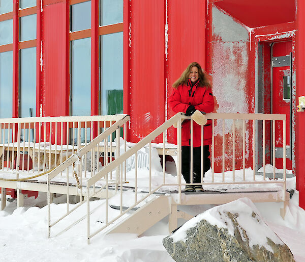 Antarctic Station Leader Narelle Campbell in front of the Casey station living quarters.