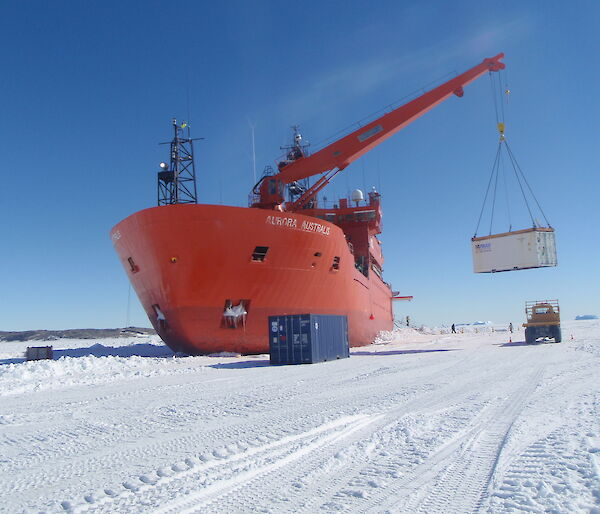The Aurora Australis unloads cargo on the fast ice at Davis station.