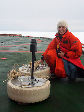 Dr Alison Kohout with two of her wave sensors on the stern of the Aurora Australis during the Sea Ice Physics and Ecosystem eXperiment (SIPEX-II) voyage in September 2012.