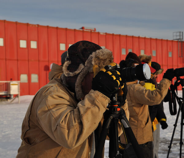 Casey expeditioners prepare their cameras ready for the solar eclipse