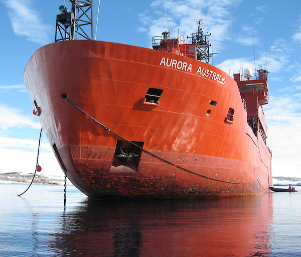 The bow of the Aurora Australis with lines running from the ship