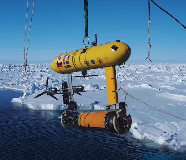 The Autonomous Underwater Vehicle (AUV) being lowered off the stern of the ship. The data from the AUV is used to make 3-D maps of the underside of the sea ice.
