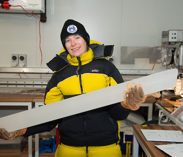 Dr Tessa Vance with an ice core from Aurora Basin in the new ice core facility at IMAS.