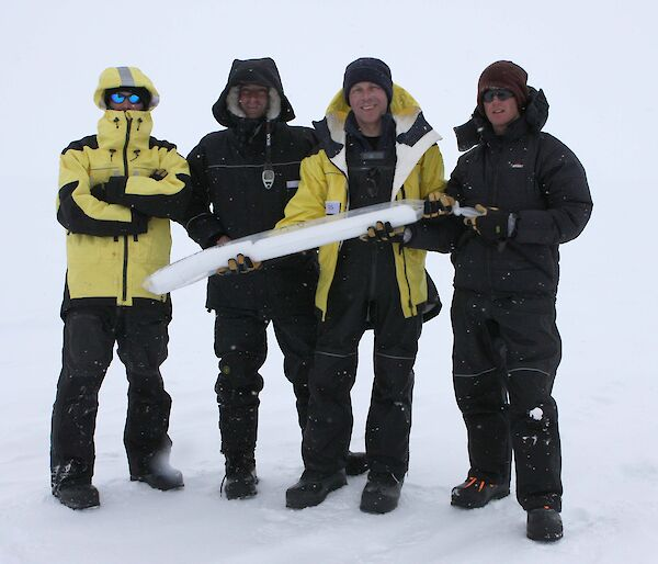 Scientists holding ice core