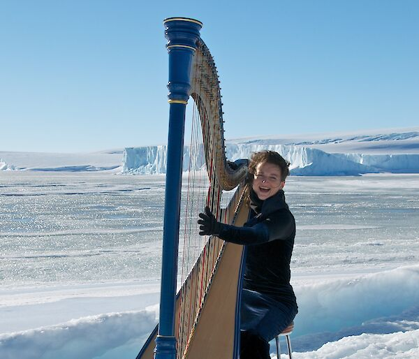 Harpist Alice Giles playing her harp on the sea ice