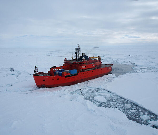 The Aurora Australis parked beside an ice floe