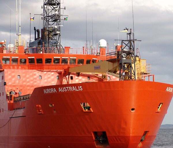 The bow of the red Aurora Australis in open water.
