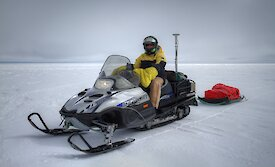 University of Tasmania scientist Dr Reed Burgette on a skidoo equipped with Global Positioning System equipment to obtain high resolution in situ estimates of surface topography, required to validate airborne and satellite data.