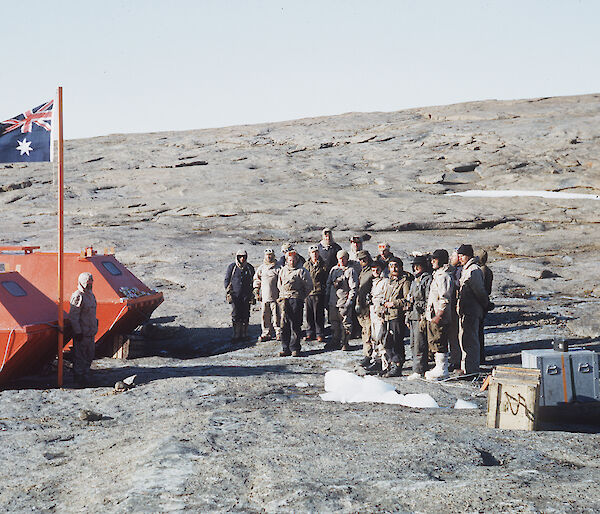 Raising the flag at the establishment of Mawson station