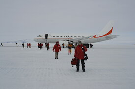 Antarctic Division personnel disembarking the A319 aircraft on the ice at McMurdo station
