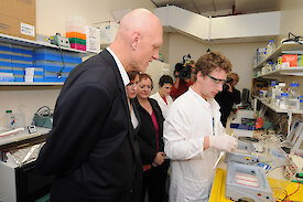 Minister Garrett and others in science lab