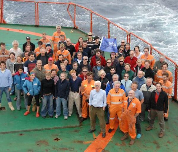Group of expeditioners on the heli deck of the Aurora Australis.