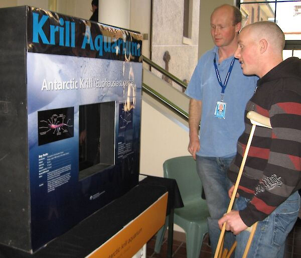 Marine scientist Rob King (left) discusses Antarctic krill with a visitor.