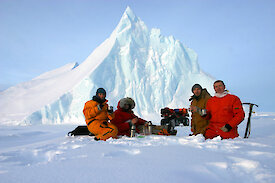 Expeditioners stopping for an icy picnic