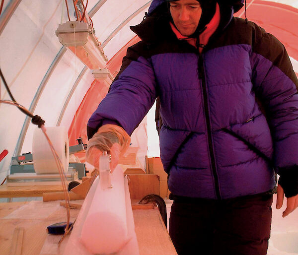Scientist with ice core