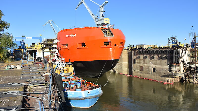 The ship in the wet dock being prepared to move out into the River Danube.