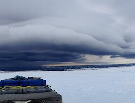 Cloud associated with strong winds in panorama over water