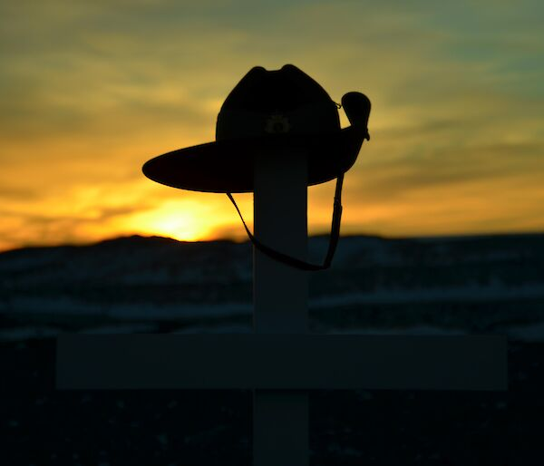 Sunrise at Davis Anzac Day 2012 — sunrise behind army hat