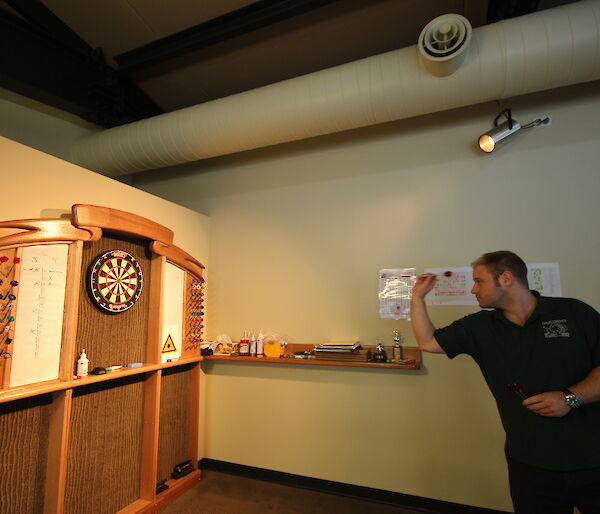 Man playing darts
