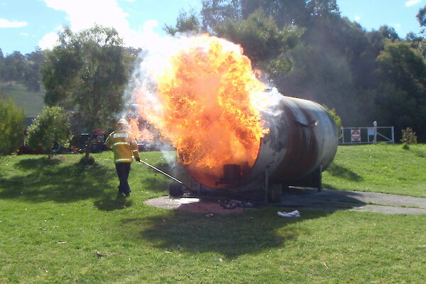 A large fire ball comes out of a gas tank during fire fighting training at Kingston