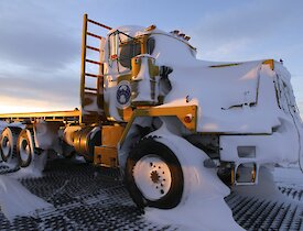 The sun shining on the Mack truck which stood the test of Mother Nature with only snow the trace of the past blizzard