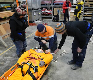 Maria, Matt and Andrew attending to the patient