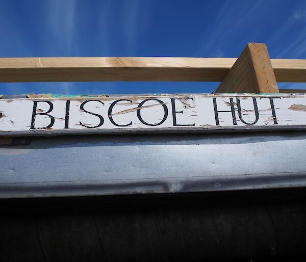 The name plate Biscoe Hut above the door
