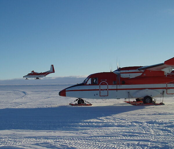 Two CASA 212 planes on the ice