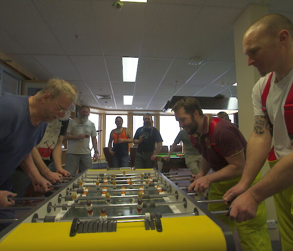 Expeditioners playing opposite each other in the tabletop football final