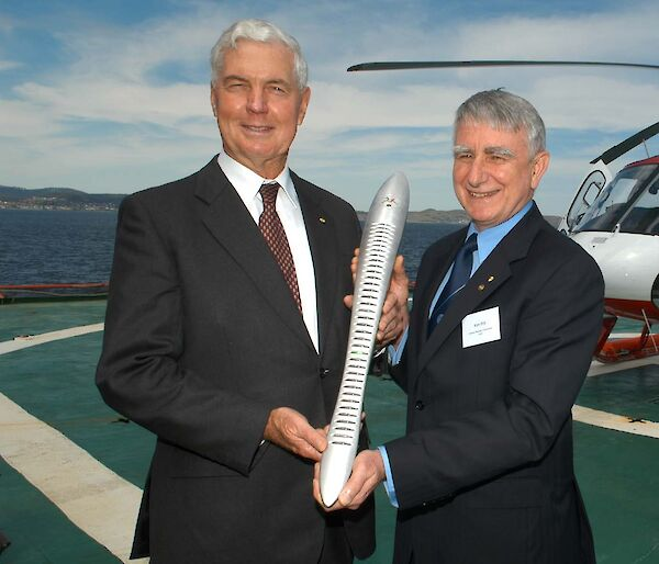 Australia's Governor-General Major General Michael Jeffery, AC, CVO, MC (Retd) and Mr Kim Pitt farewelling the Baton at a ceremony aboard Aurora Australis
