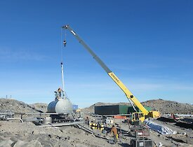 A crane is placed at the fuel tank to commence cleaning