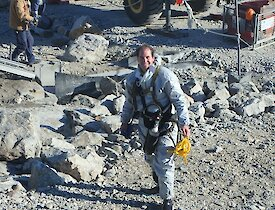 The expeditioner dressed in safety gear