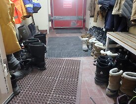 One of Casey station's cold porches with lots of boots lined up.